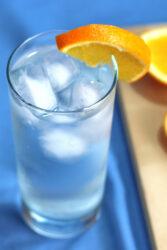 Tom Collins cocktail with orange slice