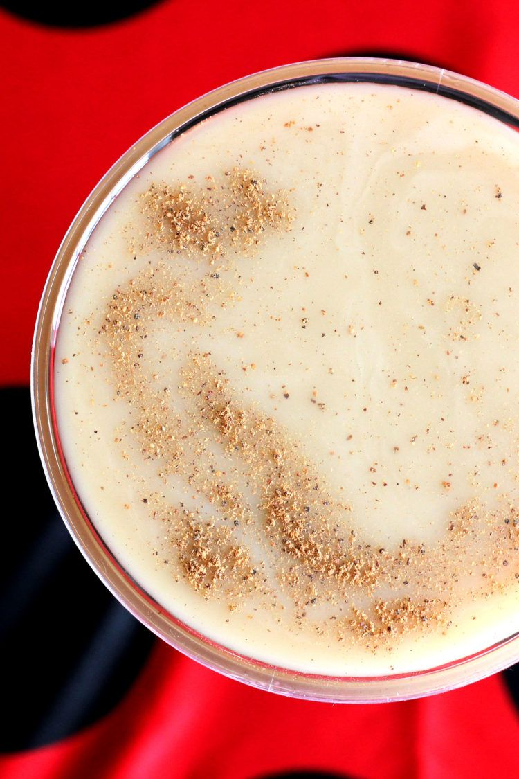 Overhead view of Brandy Alexander drink with nutmeg sprinkled on top