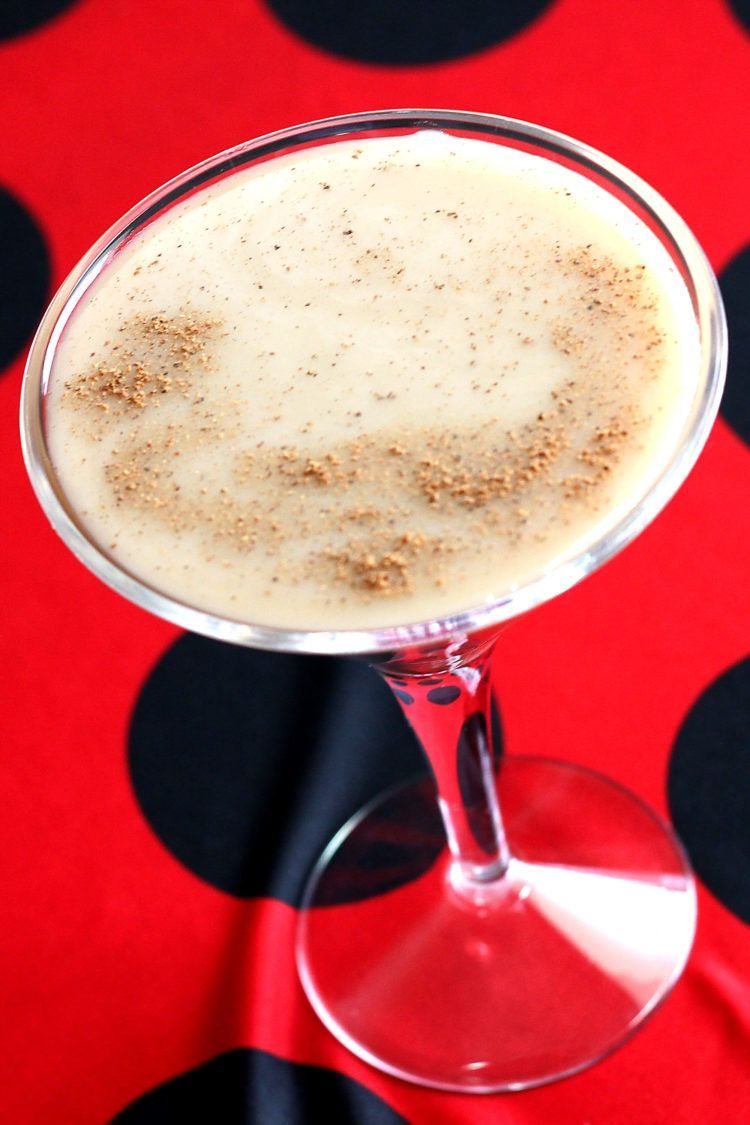 Tilted angle view of Brandy Alexander drink in martini glass with nutmeg sprinkled overtop