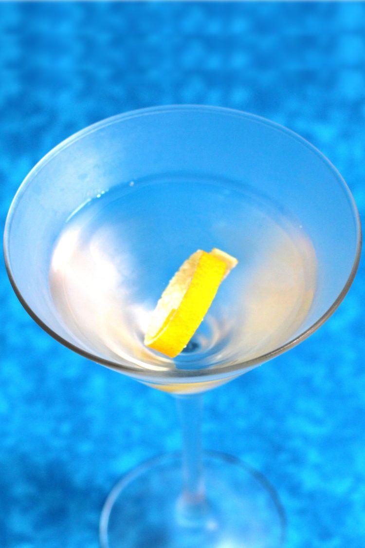 Overhead shot of gin martini with lemon twist