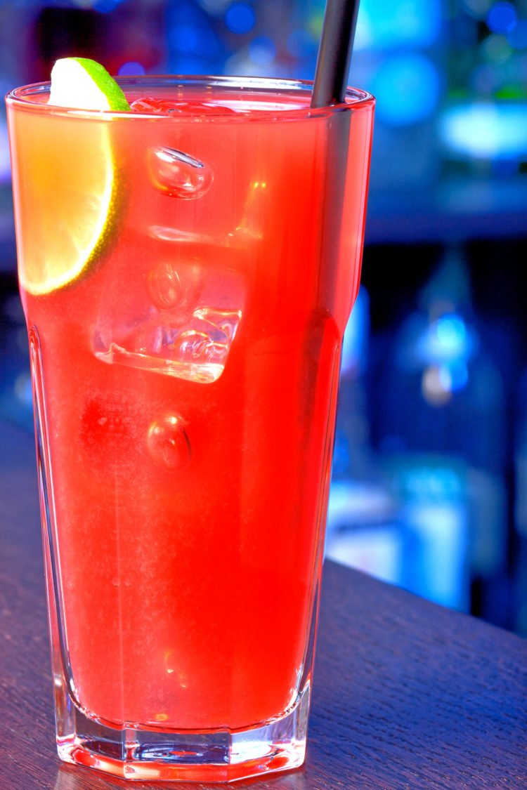 Sea Breeze drink against dark blue bar background