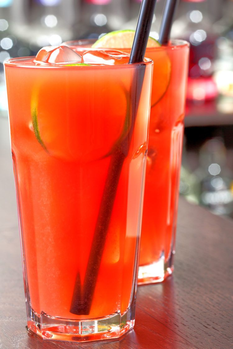 Sea Breeze drinks on bar in front of bottles