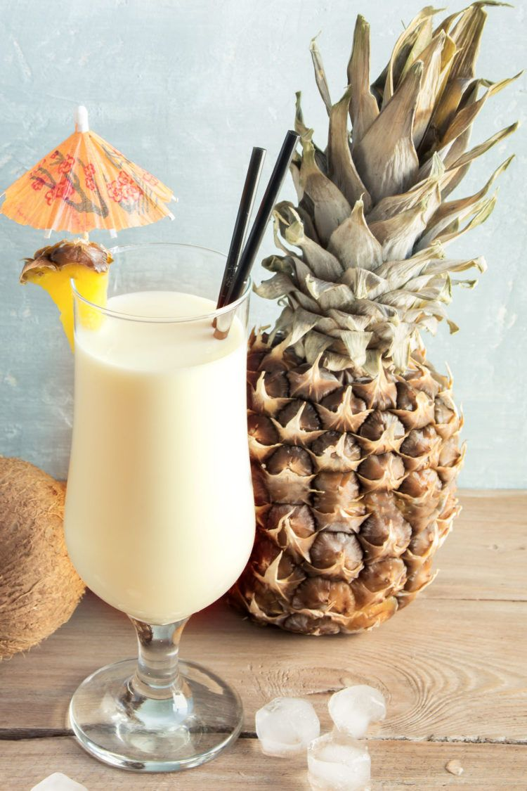 Pina Colada drink in front of coconut and pineapple