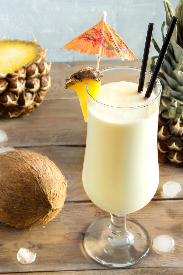Pina Colada drink on table with pineapple wedge