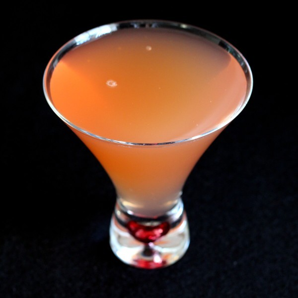 The Peking Cocktail is a rum based drink with a hint of anise flavor. That's the Pernod, a liqueur flavored with Chinese star anise. With grenadine lemon juice, it becomes a very refreshing cocktail.