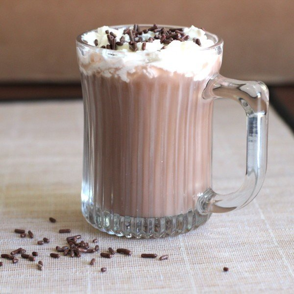 Cafe Nelson drink recipe with Bailey's, Frangelico, coffee, sugar and whipped cream.