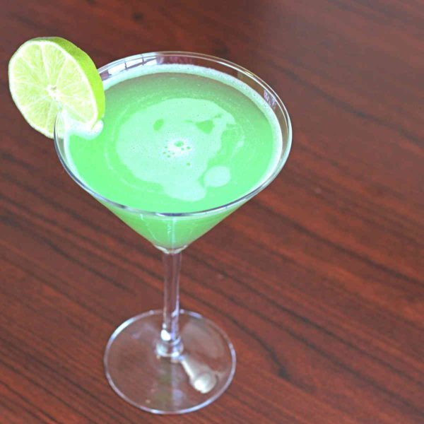 Emerald Rain drink recipe with Hpnotiq, vodka, orange and lime.