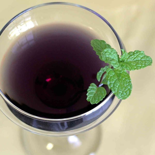 The Garnet Crow cocktail is a very dark, nearly black, red color. It's dark and mysterious, and very strong, and it features Captain Morgan's, vodka, Blue Curacao and several fruit juices – a delicious combination.