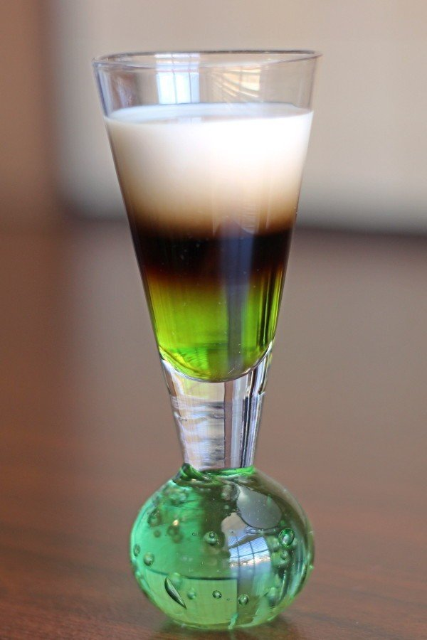 Quick Fox drink recipe layers Bailey's, Midori and Kahlua.