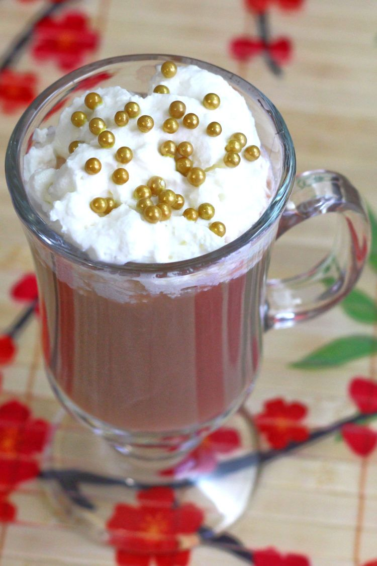 Xaviera cocktail with whipped cream and gold pearl sprinkles