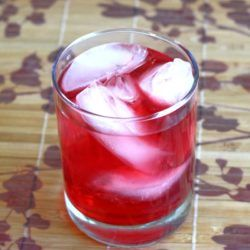 Think of the Desert Shield cocktail recipe as an upgraded Vodka Cranberry. More vodka, plus cranberry liqueur to bring out the sweetness. #desertshield #drinkrecipes #mixthatdrink #vodkacranberry #vodkacocktails #cranberrydrinks