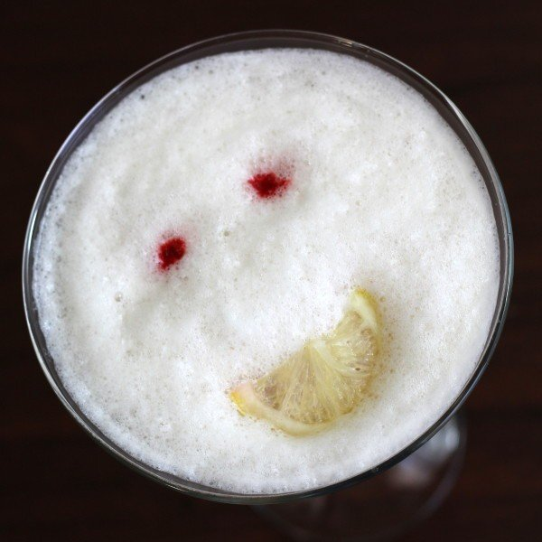Happy Face drink recipe: gin, vodka, Cointreau, tonic, orange, pina colada, whole egg