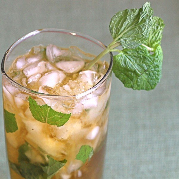 Queen's Park Swizzle recipe with rum, lime, mint, bitters and simple syrup.