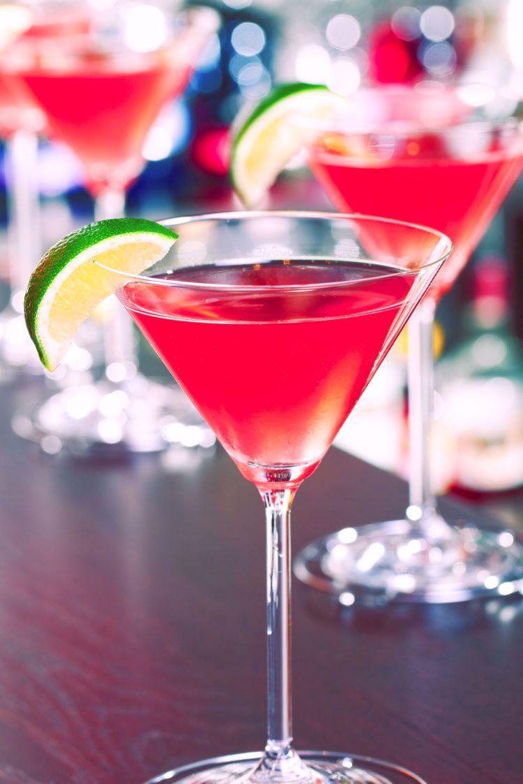 Three Vodka Cranberry drinks on a bar