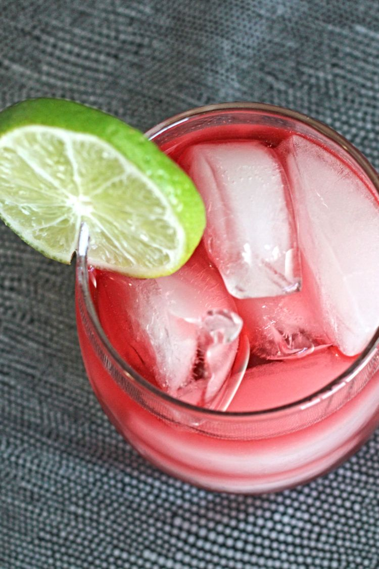 Overhead view of Vodka Cranberry drink with lime garnish