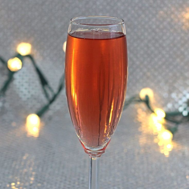 The Poinsettia is a champagne cocktail with orange and cranberry, which makes it ideal for holiday parties. It's light on the alcohol, easy to drink (even for very occasional drinkers) and festive.