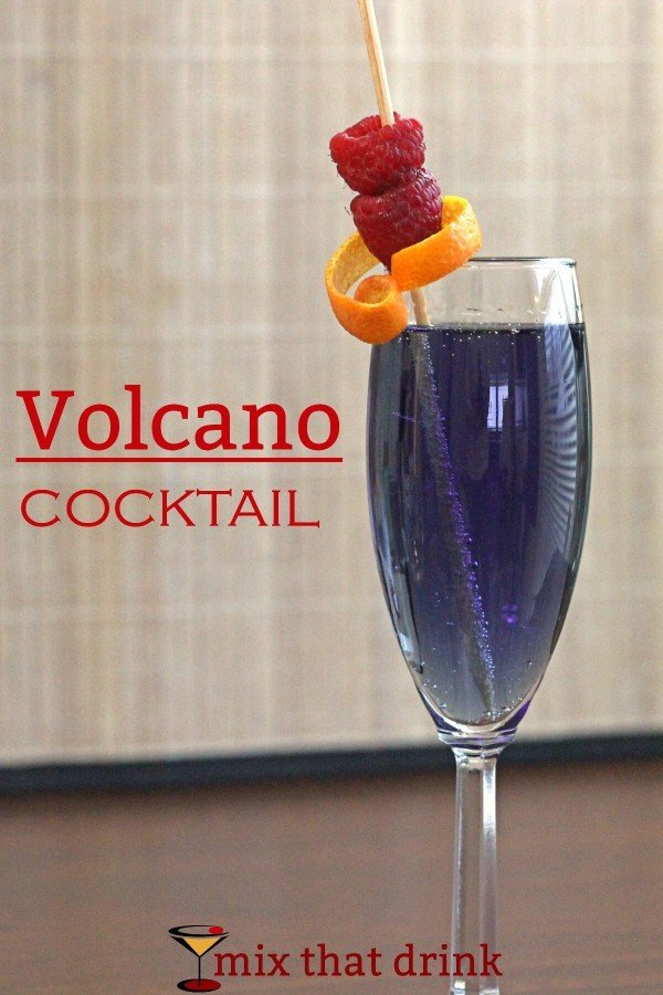 Volcano drink garnished with raspberries