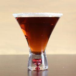 Antoine's Lullaby drink recipe with rum, port, orange curacao and lemon juice.