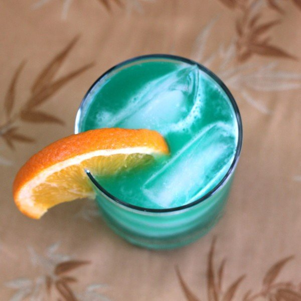 Chameleon drink recipe: Blue Curacao, Orange Juice, 7-Up