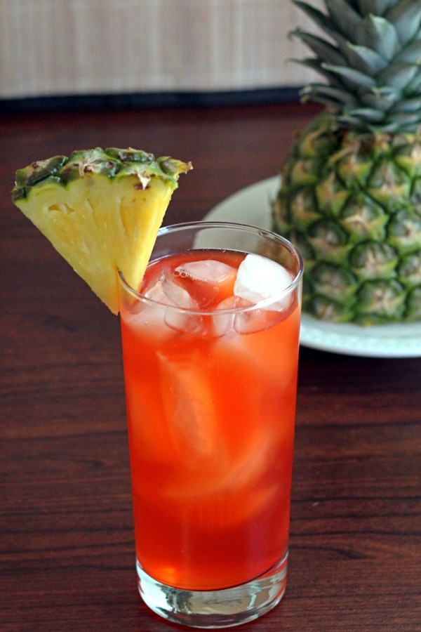 Western Sling drink recipe with cherry brandy, pineapple juice, gin, lemon and grenadine.