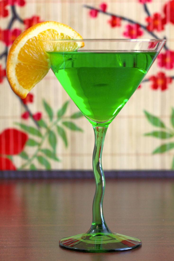 Honeydew Martini drink with orange slice