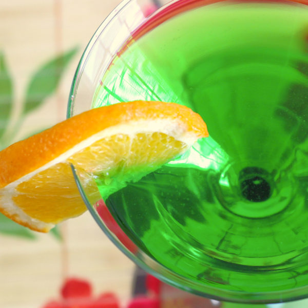 The Honeydew Martini drink recipe features Midori with vodka and triple sec. The taste of this delicious, beautiful cocktail is equal parts honeydew and orange, with a very strong kick from 3 ounces of vodka.