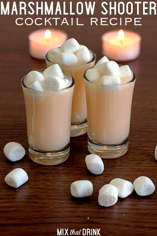 Several shot glasses of Marshmallow Shooter with marshmallows on top
