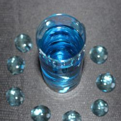 Mage's Fire drink recipe with vodka, cinnamon schnapps amd blue curacao