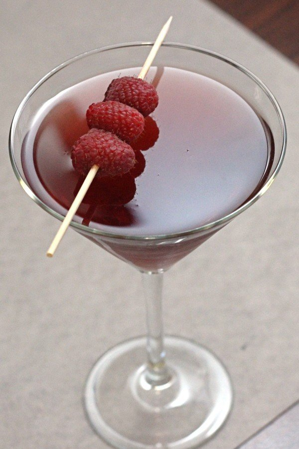 Raspberry Blush drink recipe with rum, raspberry syrup, vermouth and lime.