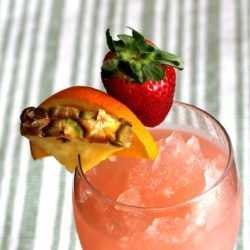 Hatian Gold drink recipe with Mandarine Napoleon, creme de bananes, rum, tequila, guava, orange, pineapple and strawberry.