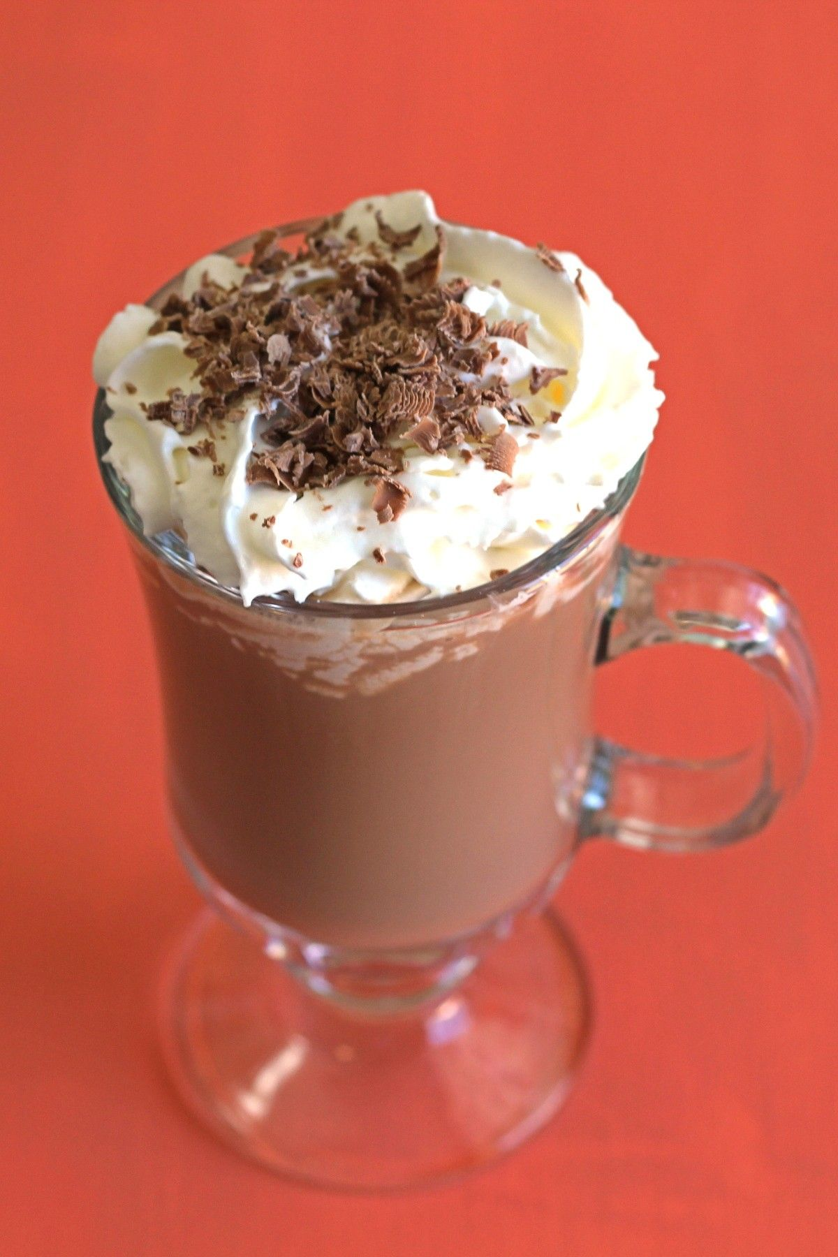 Dark brown creamy cocktail with whipped cream in Irish coffee mug aginst starry backdrop