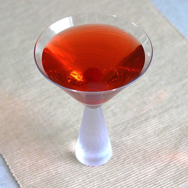 Rampage drink recipe with Captain Morgan's, peach schnapps, cranberry, pineapple and cherry.