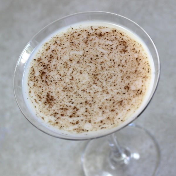 Almond Grove cocktail recipe with amaretto, creme de coconut and cocoa powder.
