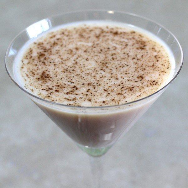 Almond Grove cocktail recipe with amaretto, creme de coconut and cocoa powder.