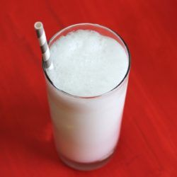 Pink Rose Fizz drink recipe with gin, club soda, cream, lemon, sugar and egg white.