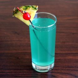 Caribbean Mist drink recipe with Malibu Coconut Rum, Midori, blue curacao, pineapple, lemon and 7-up.