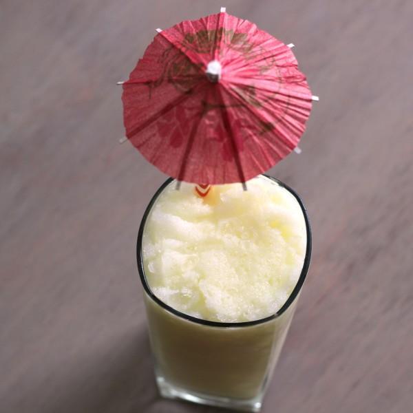 Four Wheeler drink recipe with dark rum, coconut cream, orange and pineapple.