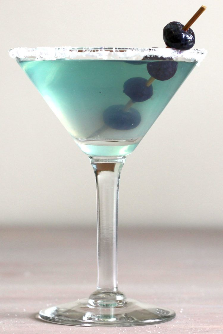 Beautiful blue-green Neato Bandito drink with speared blueberry garnish