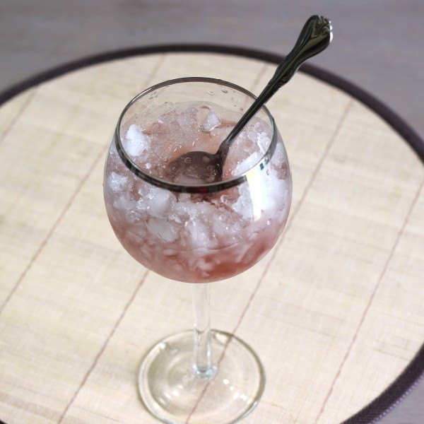 Pavlova Supreme drink recipe with shaved ice, chilled vodka and creme de cassis.