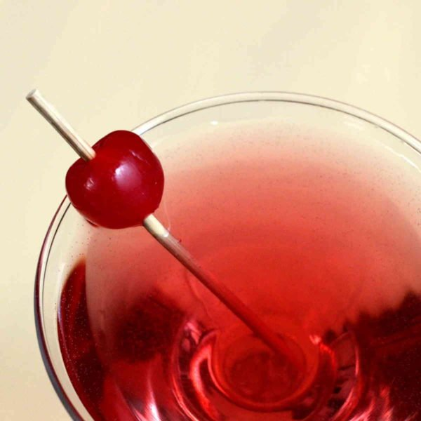 Chocolate Cherry Cha-Cha drink recipe with Malibu Rum, chocolate vodka, cherry liqueur and sparkling water.