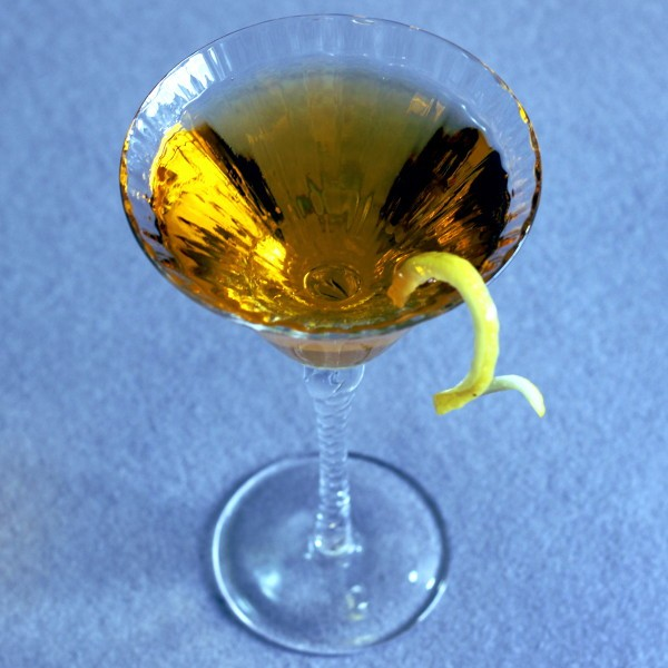 Tilted angle view of Loch Lomond drink with lemon twist