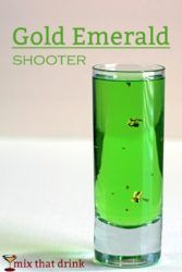 Gold Emerald Shooter drink with gold flecks floating