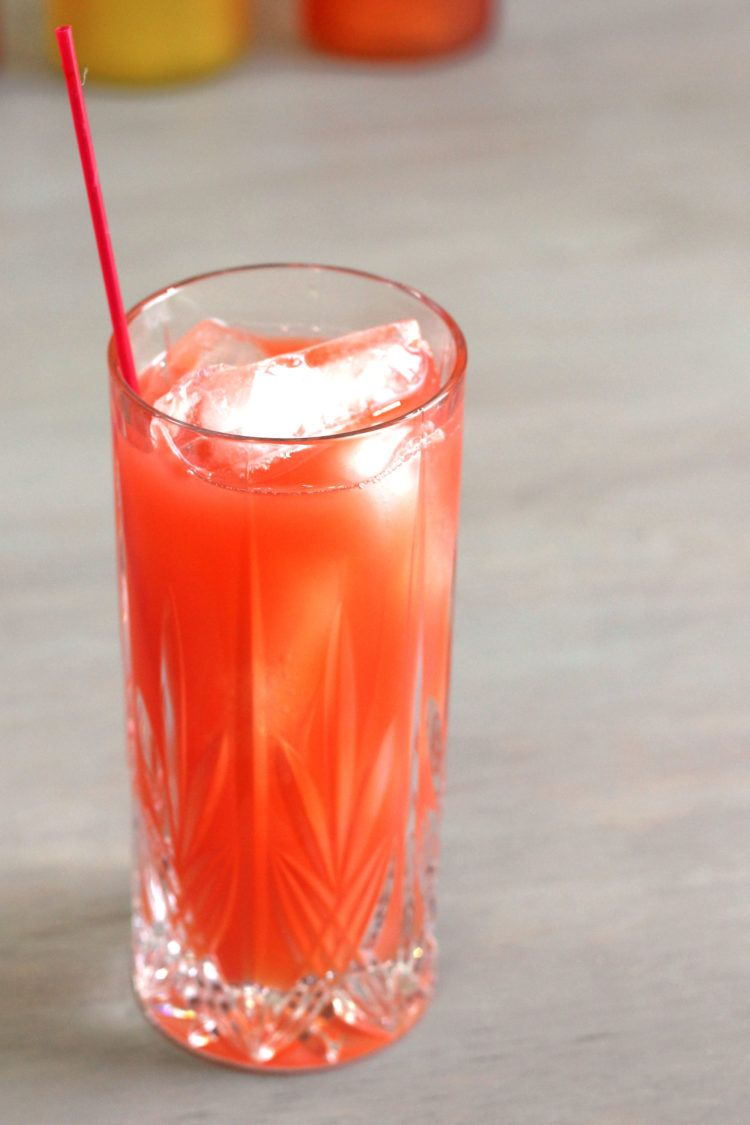 Red Death drink in front of bottles