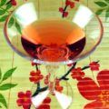 Translucent red cocktail in martini glass