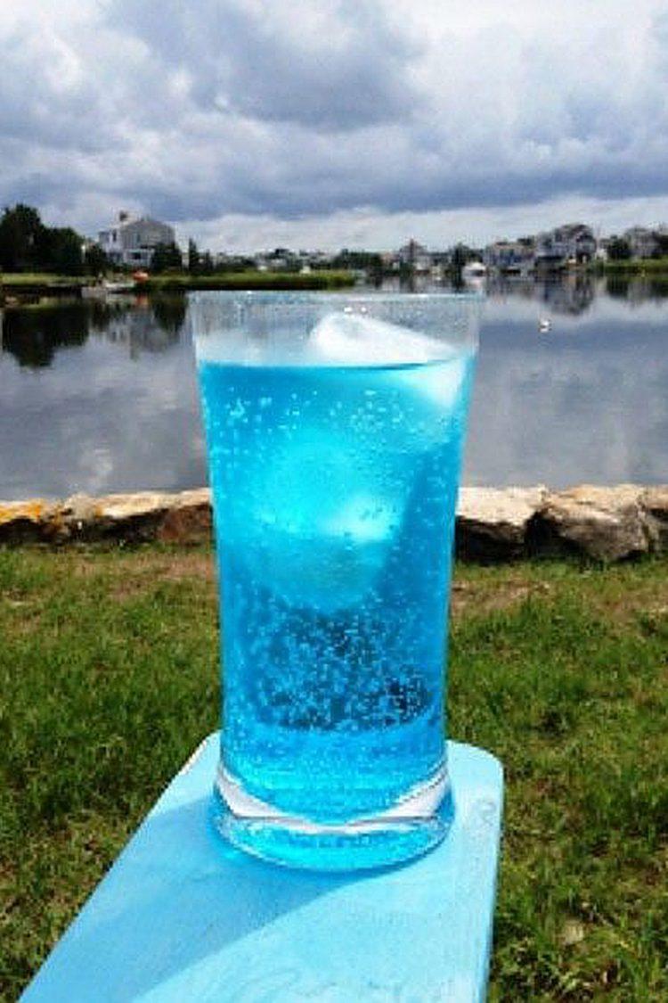 Hard Ocean Water drink in front of lake