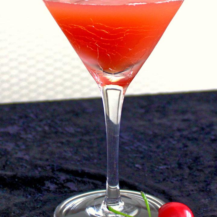 Halloween Brew drink recipe with Pumpkin Pie Vodka, orange and cranberry Juice.