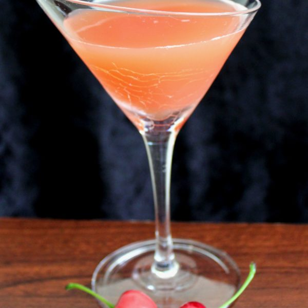 The Halloween Brew drink recipe features Pumpkin Pie Vodka with orange and cranberry Juice. This cocktail has a wonderful fruity flavor with hints of pumpkin spice. #mixthatdrink #halloween #drinkrecipes #halloweendrinks