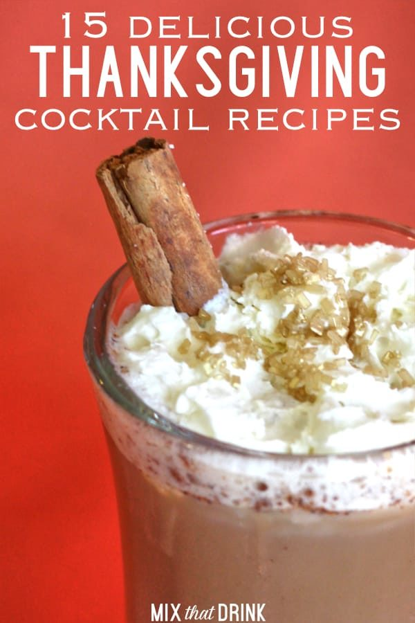 Thanksgiving cocktail with whipped cream and cinnamon sticks