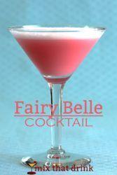 Fairy Belle Cocktail against blue background