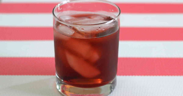 Spiced Watermelon Cooler drink on red and white tablecloth